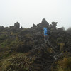 Climbing up big lava boulders.