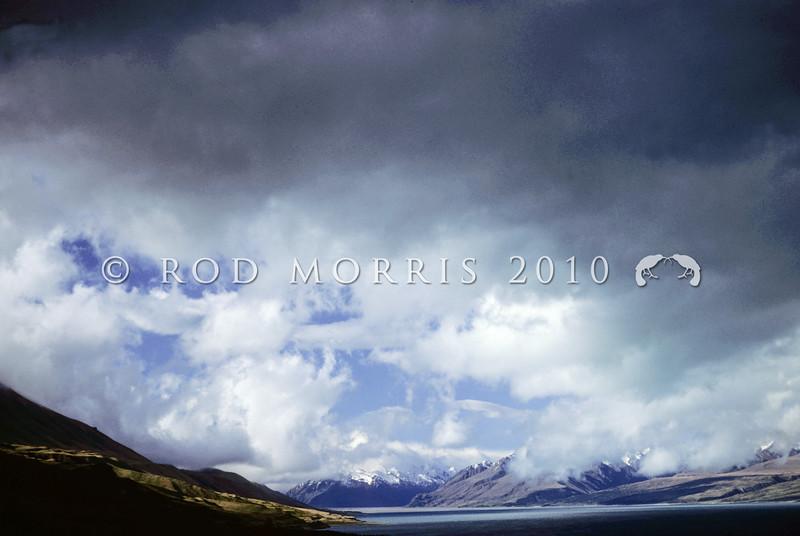11011-71013  Mackenzie Country scenery. Summer storm clouds gathering over Lake Pukaki *