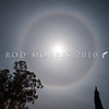 DSC_6132 Moon ring or Ice halo. A 22° halo is an optical phenomenon, forming a circle  around the moon or more commonly the sun. It forms as light is refracted in millions of randomly oriented hexagonal ice crystals suspended in the atmosphere. These ice halos appear when the sky is covered by thin cirrus clouds that often come a few days before a large storm front.