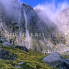 11011-57018 Fiordland scenery. Waterfall and mist shrouded 'Shadowland Wall' in the upper reaches of Sinbad Gully *