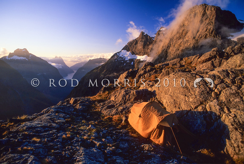 11003-22015 Fiordland scenery. Campsite on Adelaide Saddle at sunset, looking down the Cleddau Valley towards Milford Sound *