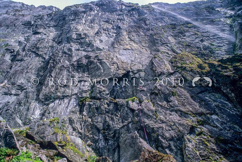 11003-22221 Fiordland scenery. Rock climbers on 'Shadowlands Wall' in upper Sinbad Gully *