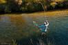 Sean Andrews being taken downstream on the Taharua.