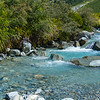 Cool water of Hooker River flowing over rocky river bed.