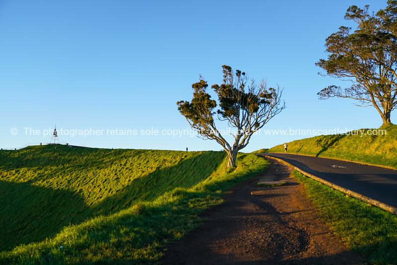 Lone distant runner on Mount Eden