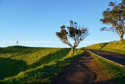 Lone distant runner on Mount Eden