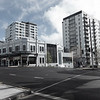 Lowrise traditional style buildings with medium rise apartments across intersecton on Karangahape Road