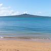 Rangitoto Island on distant horizon vertical.