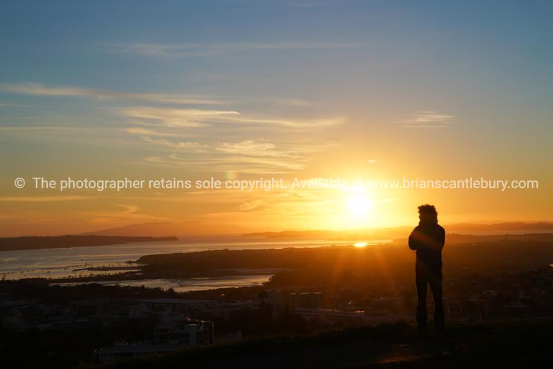 Sunrises over Auckland from top Mount Eden
