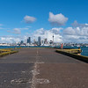 Auckland city skyline beyond Stanley Bay pier and harbour