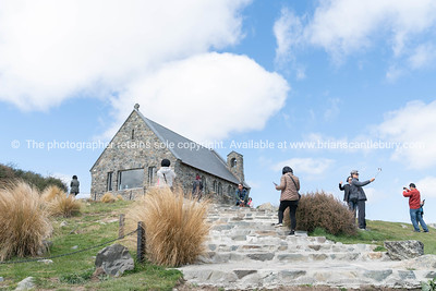 tourists viewing and  taking photos around iconic  Church of Good Shepherd
