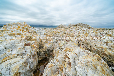 Rugged white sandstone and overcast cloud formation