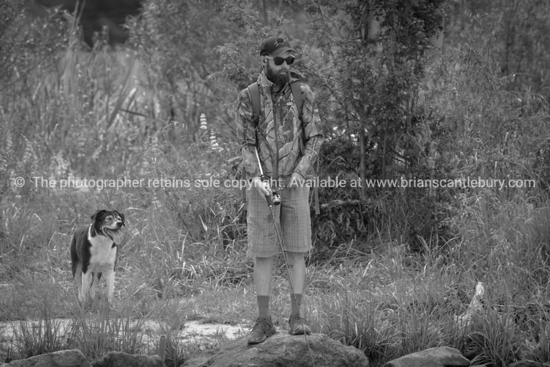 Fishernam and his dog on bank of Kaiapoi River