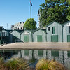 Closed doors of row of green boatsheds along Avon River