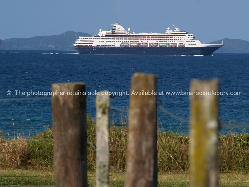 Cruise ship passes by close to Opito Bay.