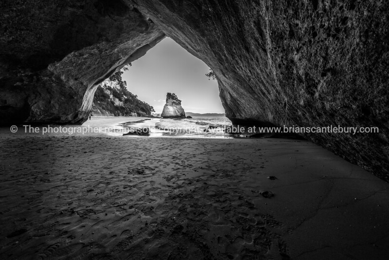 Scenic view through natural arch of Cathedral Cove on Coromandel peninsula New Zealand.