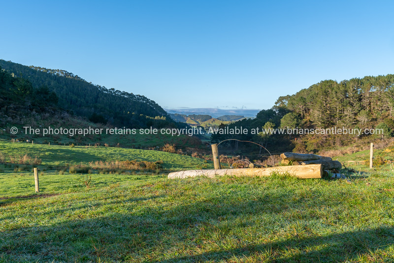 Long view across New Zealand farmland in cool spring morning about sunrise.