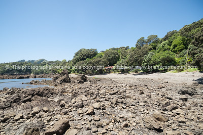 Quiet Whanarua Bay kayaks and boats. New Zealand images.