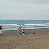 Walking the dog. Waiotahi. East Coast. New Zealand Images.