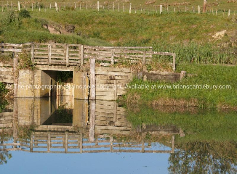 Farm waterway reflections.