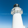 East Cape Lighthouse, with  East Island just beyong the cape.. East Coast New Zealand.