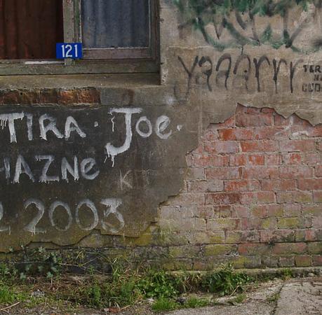 Old wall of mixed materials and graffiti. Tokomaru Bay. New Zealand images.