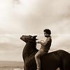 Rihari O'Brien and horse on Te Kaha Beach