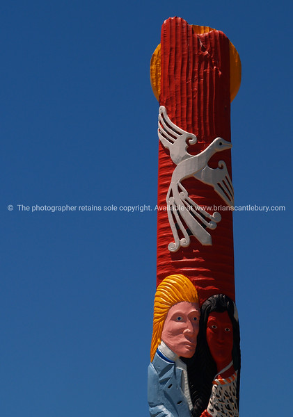 Maori carving depicting the coming together of two cultures at Waiotahi.