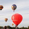 Fleet of balloons float above Hamilton.