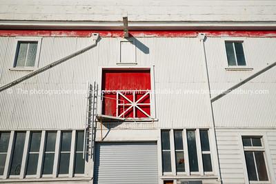 Red loading door in old industrial building, Napier, New Zealand.