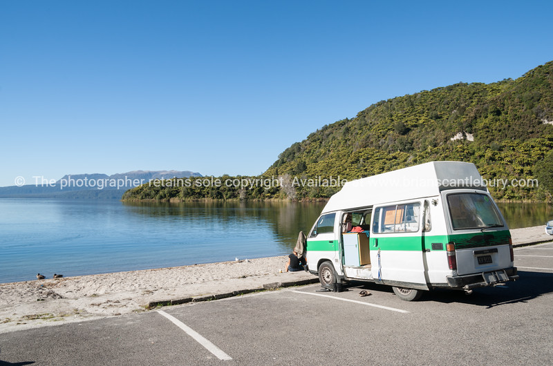 Lake tarawera and tourist camper van.