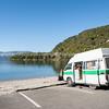 Lake tarawera and tourist camper van.