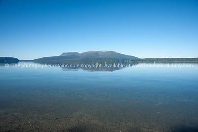 Scenic Lake Tarawera with Mount Tarawera across the water.