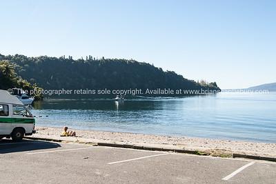 Tourists and fishers boats on Lake Tarawera.