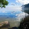 Scenic lake landscape as mist rises