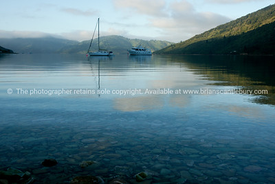 Endeavour Inlet, calm morning, boats anchor. New Zealand Images.