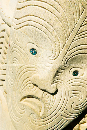 Indigenous carving in sandstone. New Zealand image.