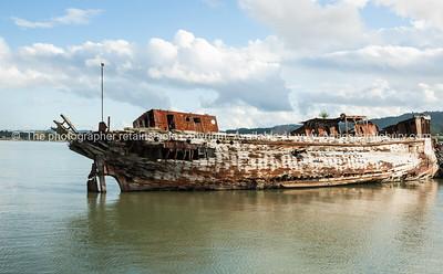 Deserted old barge at Miranda on Coromandel Peninsula. New Zealand images.