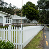 White picket fence lined street along Russell's waterfront.