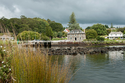 Historic stone store across the inlet at Kerikeri, Northland. New Zealand images.