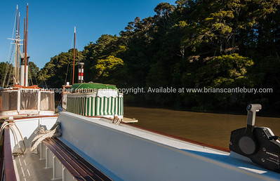 Restored boats on river at Warkworth, Northland. New Zealand images.