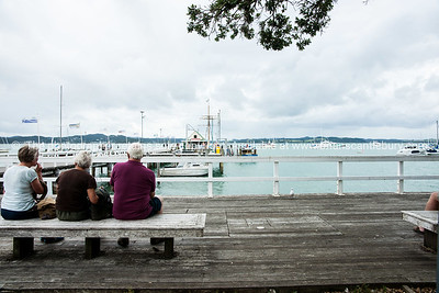 Russell waterfront. Three visitors await the return ferry. Northland