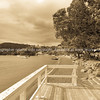 Russell waterfront steps to beach, deck and pohutukawa trees lining the road sepia toned , Bay of Islands, Far North North.