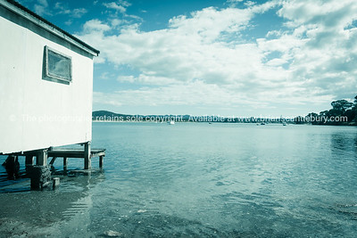 Boatshed on piles over edge of scenic estuary at Ngunguru Northland New Zealand
