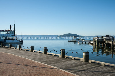 Lake Rotorua waterfront with float plane and Lakeland Queen paddleboat.