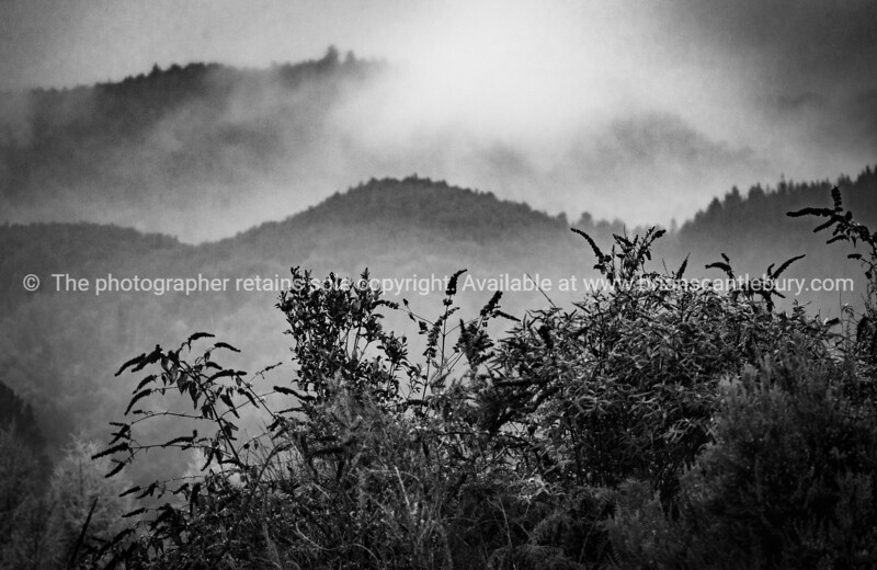 Tiered mountains shrouded in mist