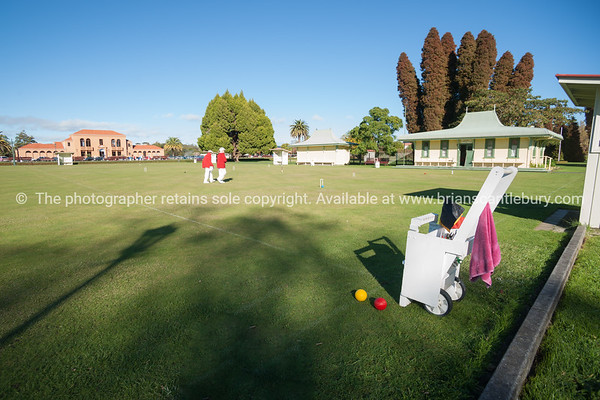Croquet lawn, two players and trolley