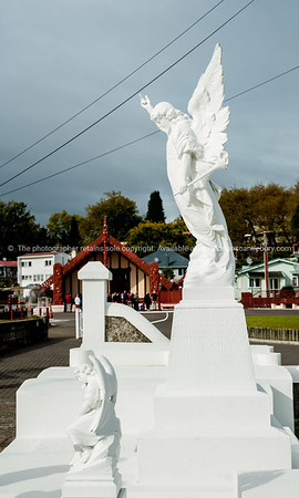 White angel in front of Ohinemutu Marae with group of tourists receiving the introduction. Rotorua