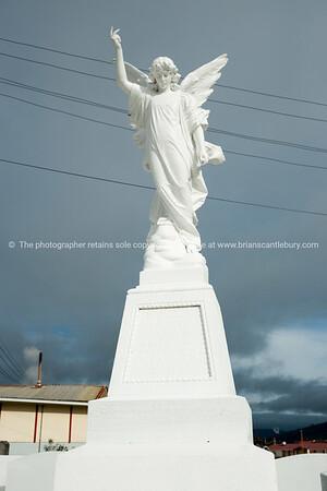 White angel atop memorial headstone. Ohinemutu, Rotorua.