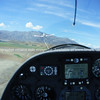 View from with glider glider cockpit while under tow from tow-plane.